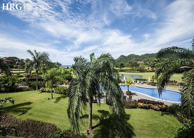 View of the garden, pool area and golf course. - Adventure Awaits at Luxury Condo located at Los Sueños Resort and Marina. - Herradura - rentals