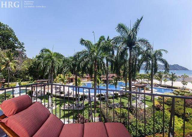 Balcony with view of the beach club and herradura bay. - STAY 7 NIGHTS-PAY 5, Luxurious Condo, located next to beach club + amenities! - Herradura - rentals