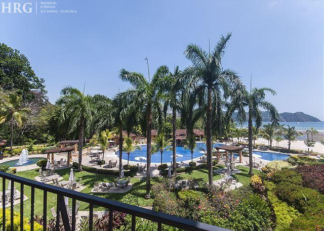 Balcony overlooking pool area.  - Ocean Breeze Condo with Spectacular View, close to beach club at Los Sueños! - Herradura - rentals