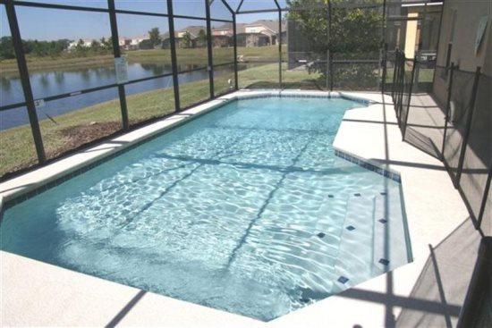 Beautiful 5 Bedroom 3 Bath Pool Home with Lake View. 17625WW - Image 1 - Orlando - rentals