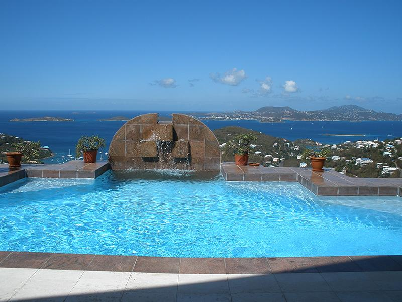 Panoramic ocean views beyond waterfall pool - Sunset Vista Villa - Saint John - rentals