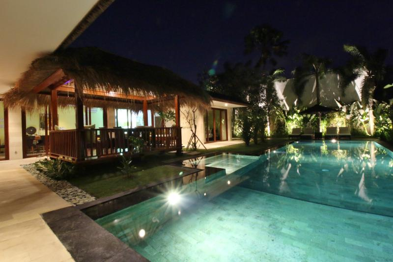 The pool and gardens are beautifully lit at night - SPARKLING, SAFE, SPACIOUS - Villa Rajawali - Canggu - rentals