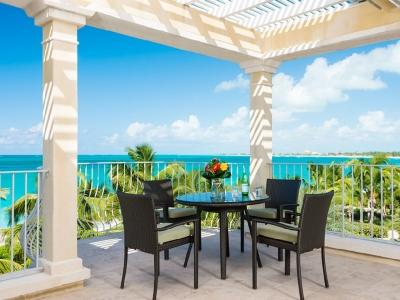 Expanded terrace for dining and relaxing. - 3rd Floor Deluxe 3 Bedroom Villa #308 (sleeps 6-7) - Grace Bay - rentals