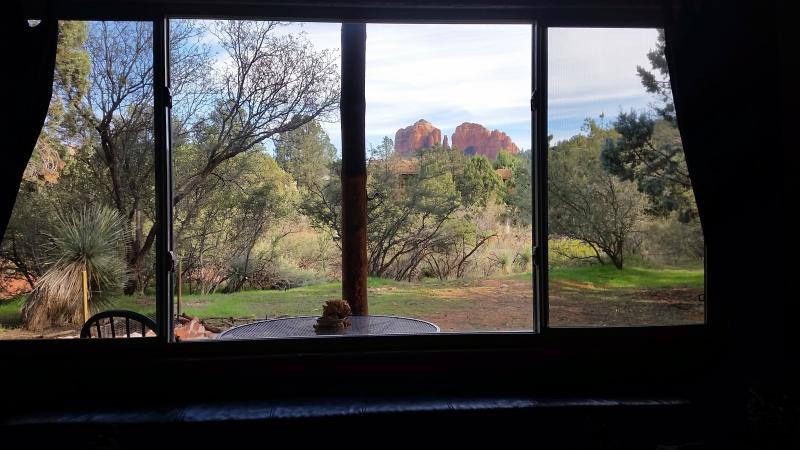 View of Cathedral Rock greets you at entry and captivates sunrise to sunset from l.r., d.r., patio. - Cabin with Cathedral Rock View; Private and cozy! - Sedona - rentals