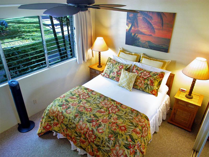 Bedroom with new blackout drapery, linens, ceiling fan, and Samsung 24-inch flat screen HDTV. - Cozy Quiet Garden View Condo, Kihei Kai Nani, Maui - Kihei - rentals