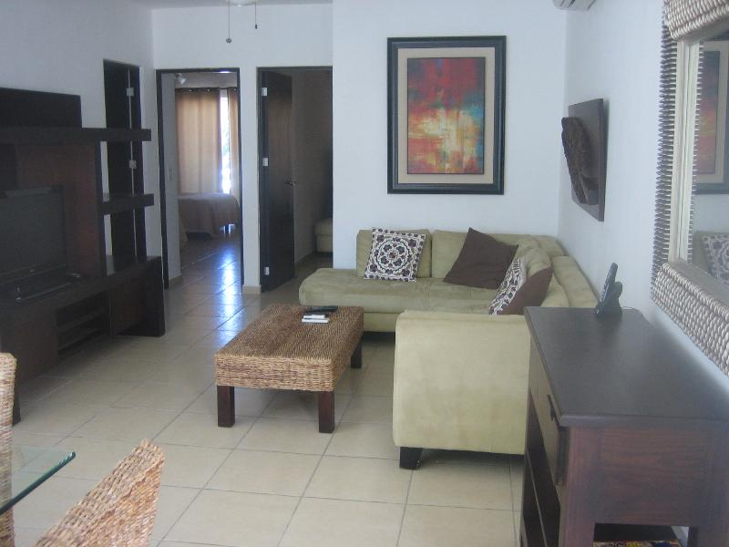relaxing living area with tv, wifi, large sectional sofa - Beautiful Penthouse with Private Rooftop Terrace - Playa del Carmen - rentals
