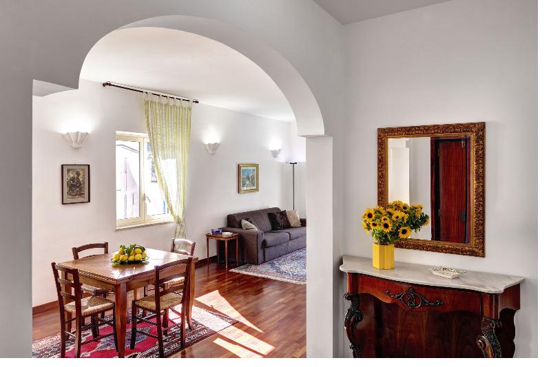 The bright, spacious sitting room furnished with warm wooden floorboards - Caruso,situated in Sorrento Center, Panoramic View - Sorrento - rentals