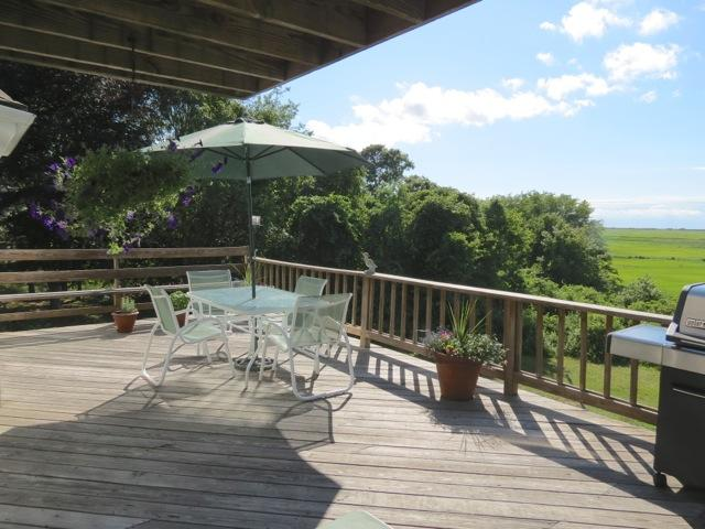 Oversized deck invites outdoor living.  Wait'll you see the sunsets from here! - New, spacious, casually elegant with views - 060-Y - Yarmouth Port - rentals