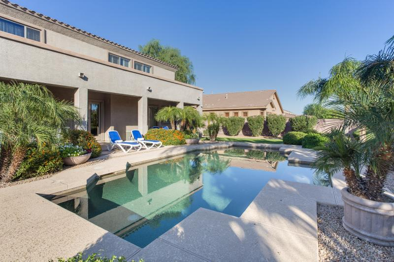 Large backyard with large pebble tech heated pool and in-ground cleaning system - FLORENCE ESTATE in Goodyear with resort backyard - Goodyear - rentals