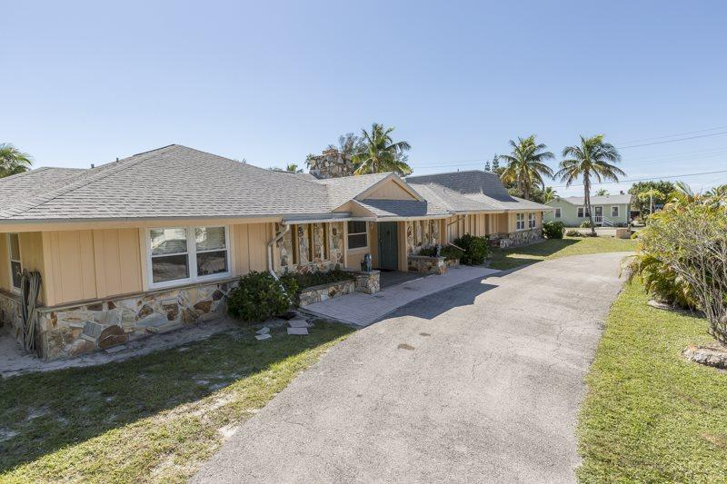 1/35: Exterior on Aberdeen Ave. looking toward the beach - Exceptional Executive 6 Bedroom rental home across from Fort Myers Beach with new granite kitchens and decor - Code: Sun Palace - Fort Myers Beach - rentals