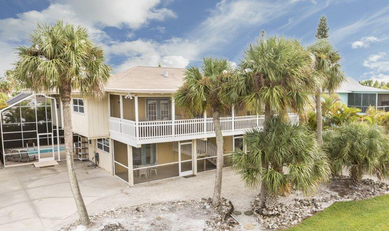 Sun Castle, our large Key West Style Family Vacation home with Private Pool and Hot Tub, All new decor, wood floors and Granite Kitchen - Code: Sun Castle - Image 1 - Fort Myers Beach - rentals