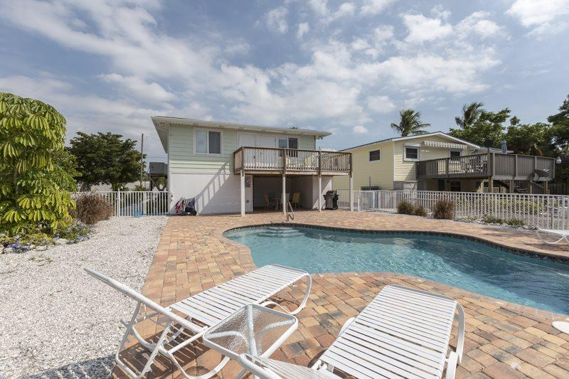 1/17: Beach Nuts exterior view from pool area - Beach Nuts Canal Home with New Pool by the Pier open Dec 27th 6 Nights! - Code: Beach Nuts - Fort Myers Beach - rentals