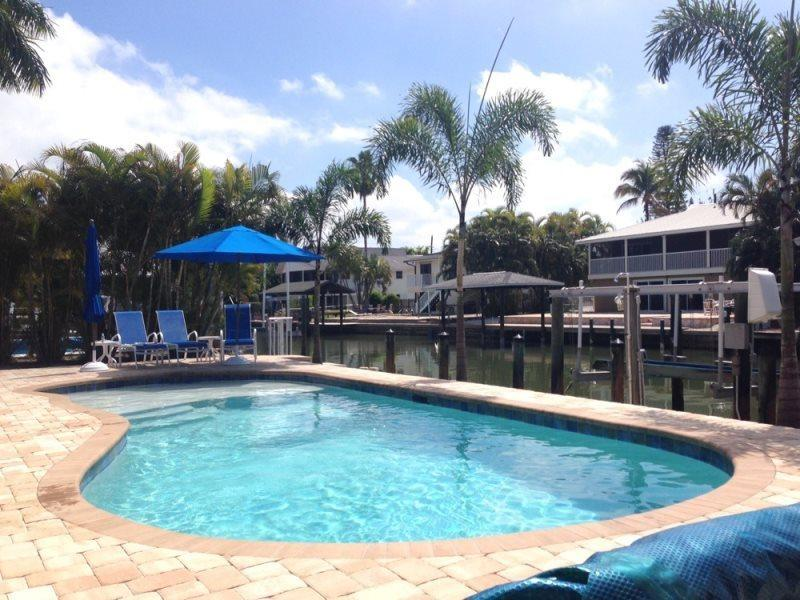 1/15: Beautiful pool with view of the canal - Carita Cottage offers Peaceful relaxation with new pool and designer decor - Fort Myers Beach - rentals