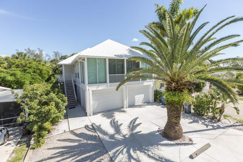 1/35: - Mango Fandango is our Brand New Pier Area Rental Home with Private Pool and Spa Just One Minute to the Beach - Code: Mango Fandango - Fort Myers Beach - rentals