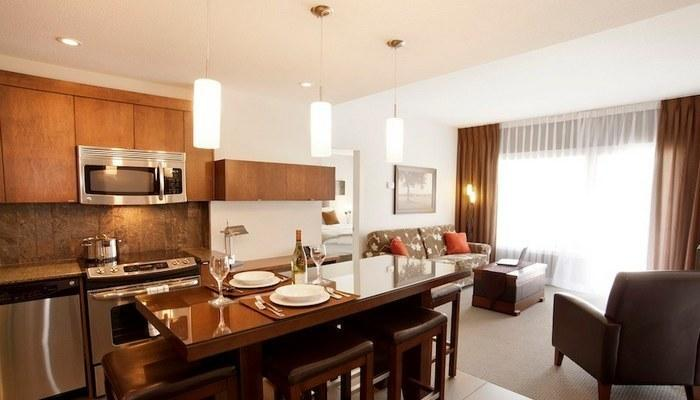 This condo's chic kitchen boasts stainless steel appliances and maple cabinets - Kimberley Mountain Spirit Lodge 1 Bedroom Luxury Condo - Kimberley - rentals