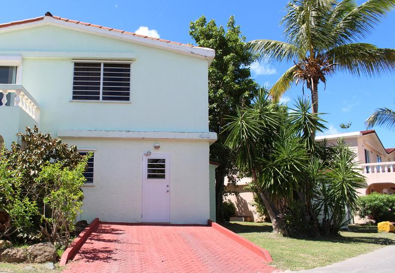 Front of the Condo with a parking space. - Hall's Waterfront Condo - Jolly Harbour - rentals
