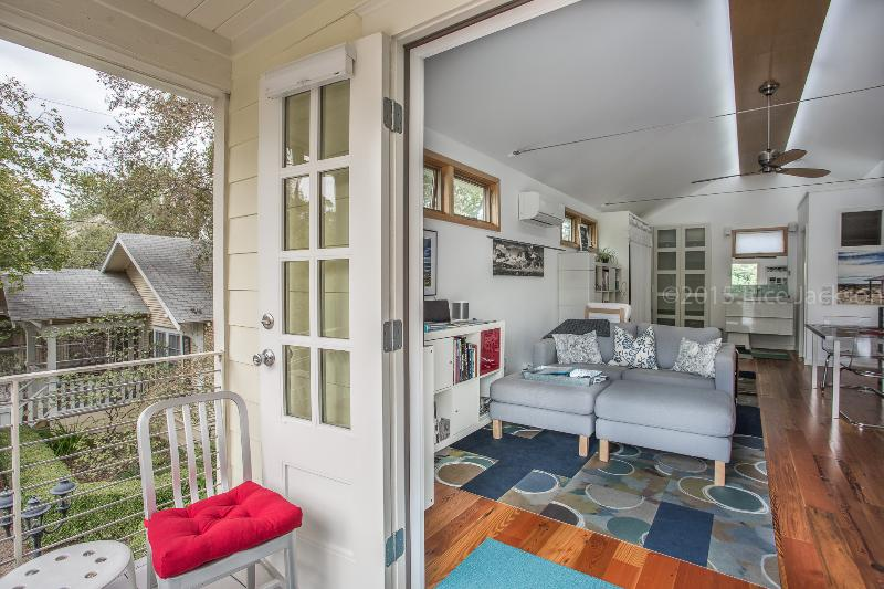 Balcony doors open to reveal the beautiful apartment inside. (Nov 2015) - Gallery House Studio Apartment - Austin - rentals