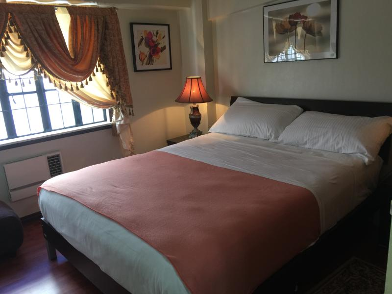 Master bedroom with own toilet and bath - A classy  2 BR  Condo in the heart of Metro Manila - Manila - rentals