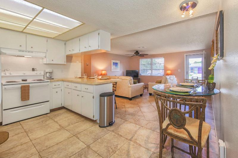 Kitchen is open to living area and screened porch is just off the kitchen - Shady 2 Bedroom Tropical Retreat - Private Beach - WiFi - Pets OK -Fenced Yard - Venice - rentals