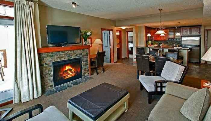 This comfortable condo features a cozy fireplace and modern kitchen. - Canmore Blackstone Mountain Lodge Beautiful 1 Bedroom Condo - Canmore - rentals