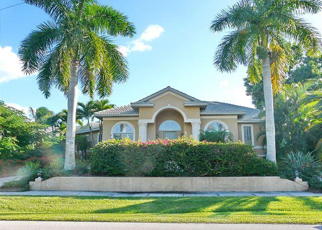 Spacious waterfront house on corner lot w/ heated pool & short walk to beach - Image 1 - Marco Island - rentals