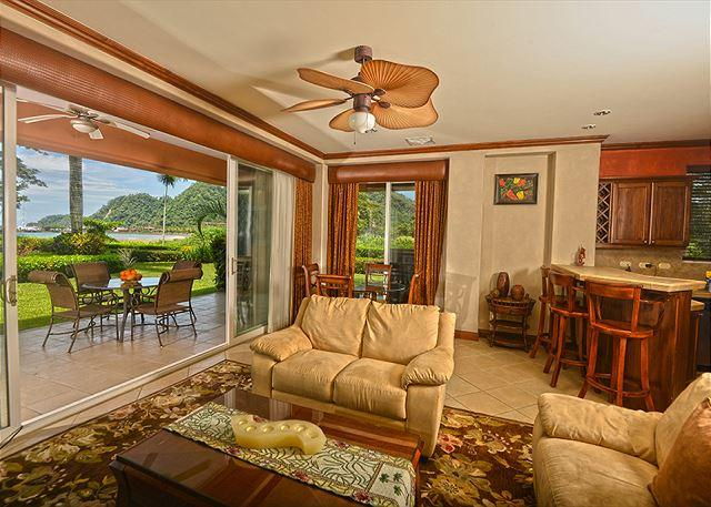 Living room with Patio, Large Garden and Ocean View. - Unique Location, Oceanfront Condo at Los Sueños. Book now Spring Break! - Herradura - rentals