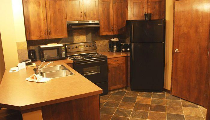 This fully-equipped, spacious kitchen has everything you need.  - Kicking Horse Glacier Mountain Lodge Cozy 1 Bedroom Condo - Golden - rentals