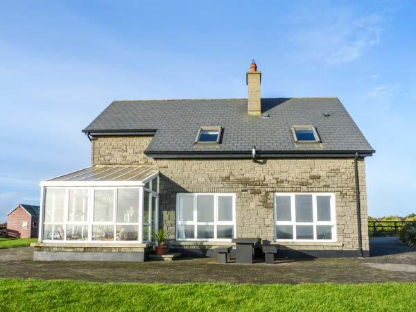 WATERS HOUSE, detached,solid fuel stove and open fire, pet-friendly, WiFi, Carrick, Ref 15402 - Image 1 - Bannow - rentals