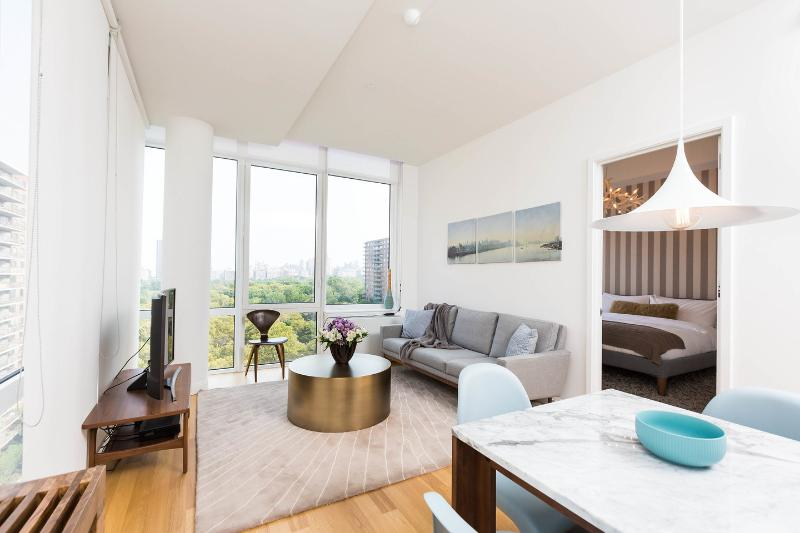 Living Room and dine-in area overlooking Central Park - The Whant Collection - Central Park-Facing Luxury One Bedroom King Suite! - New York City - rentals