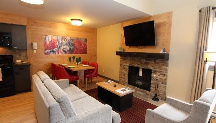 Snuggle in front of the wood-burning fireplace - Banff Rocky Mountain Resort Lofted 1 Bedroom Wolf Condo - Banff - rentals