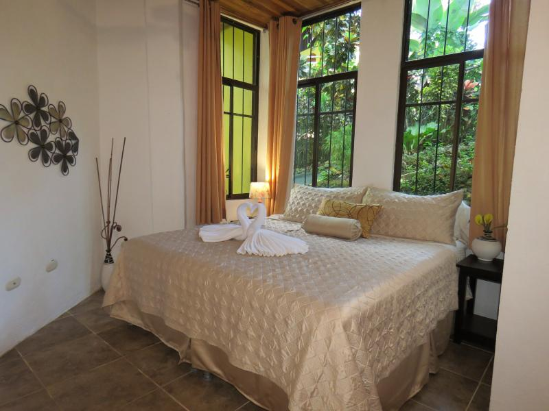 Master bedroom with King bed, large closet, safe, A/C, loveseat. All pics are taken with our camera. - King/Queen Bedrooms pool, A/C, WiFi,BBQ 1200 sq/ft - Manuel Antonio National Park - rentals