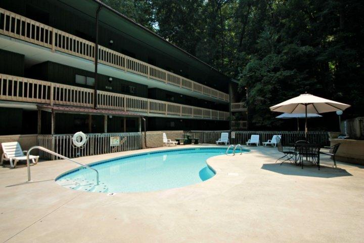 Swim a Few Laps or Just Lounge Outdoors and Relax by the Mountain Stream - Couples Retreat!  By the Stream with Wooded Views - Jacuzzi Tub - Community - Gatlinburg - rentals
