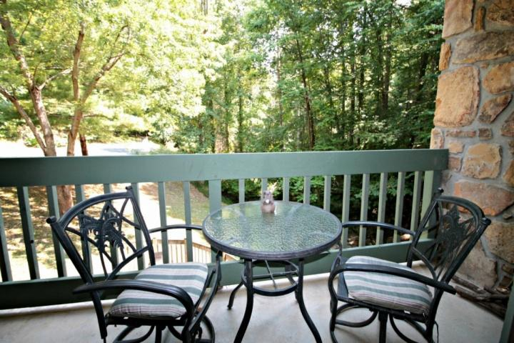 Enjoy This View from the Balcony Overlooking a Mountain Stream While Drinking Your Morning Coffee or Afternoon Wine - 154 Village Stream - Couples Retreat - Wooded Views - Jacuzzi Tub - Community Pool - WiFi - Gatlinburg - rentals