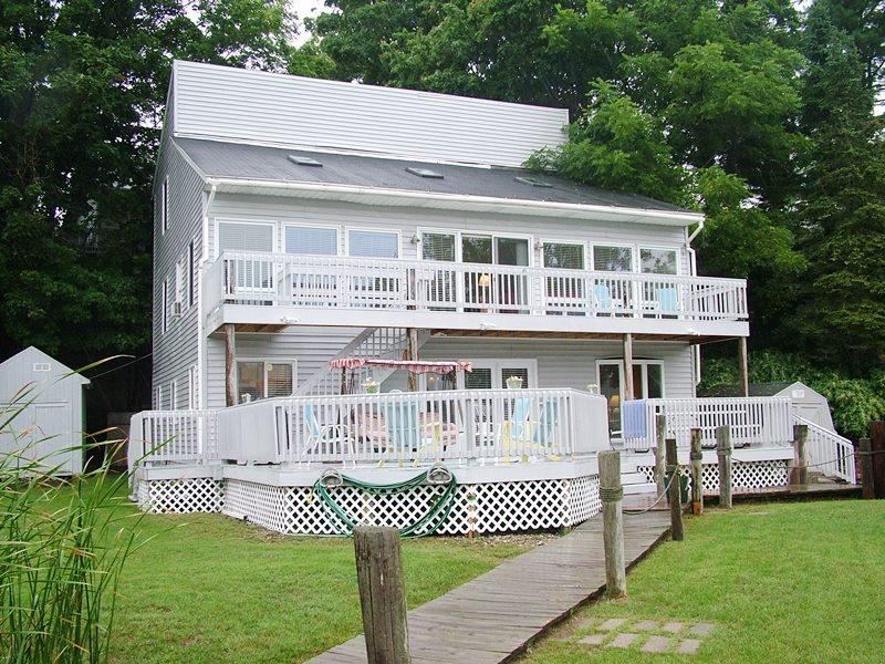 Large Multi-Level Waterfront Home. Sleeps 12. Downtown Douglas steps away! Weekly Saturday to Saturday - Image 1 - Saugatuck - rentals