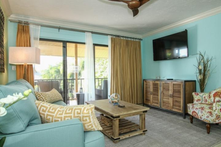 Huge fifty inch flat screen TV in this designer decorated living area w/ balcony views - Stunningly renovated 3rd Flr.,End Unit * Park Shore Resort w/private setting - Naples - rentals