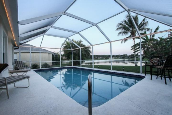 Outdoor/caged & heated pool w/stunning lake views & plenty of pool seating - Briarwood 4 BD/3BA, 2-Car Garage, Pool Home w/Sweeping Lake Views! - Naples - rentals