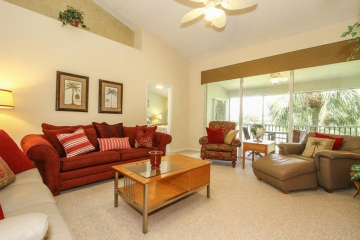 Beautifully decorated living space with queen sleeper sofa - Wedge Wood Trace at The Strand - w/Sweeping Lake & Golf Course Views! - Naples - rentals