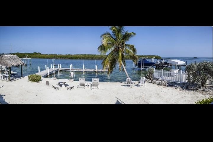 View of the outside area and dock. - **Discounted May & June Bookings!** Ocean Front House with Private Dock - Tavernier - rentals