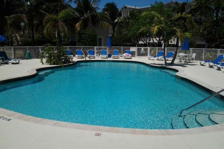 Wonderful pool and sun deck area. - Luxurious Condo at the Exclusive Bay Harbour Club in the Keys, Including a Boat Slip and Marina - Islamorada - rentals