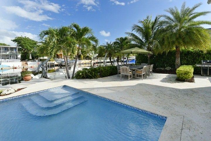Pool and patio area. - Luxurious Key Largo Family Home with Pool & Large Dock - Key Largo - rentals