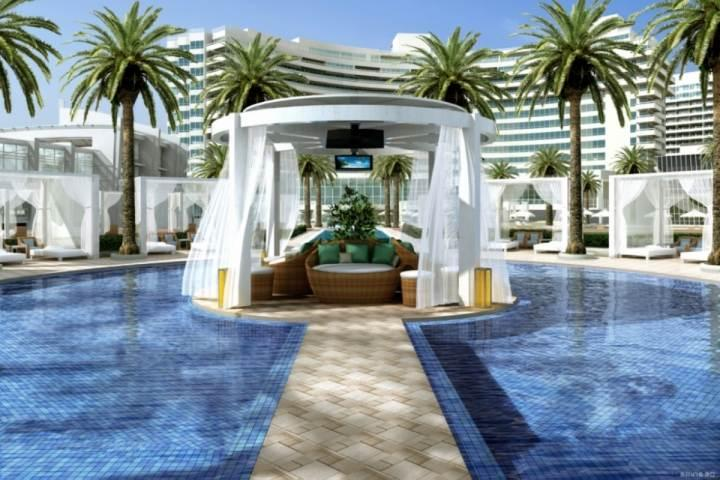 Luxurious pool and sunbathing area. - ASK US FOR DISCOUNTS - Oceanview Suite at Opulent Fontainebleau South Beach - Miami Beach - rentals