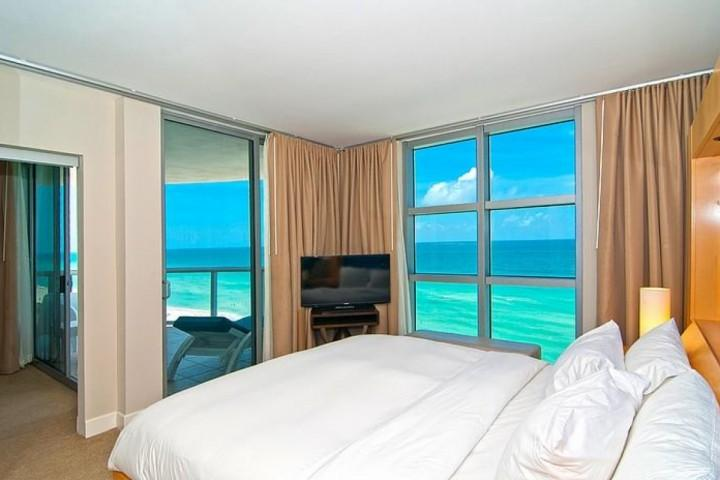 Bedroom with ocean view and a king size bed. - Luxury Oceanfront Condo at the Marenas Resort, Miami Beach - Stunning Views - North Miami Beach - rentals