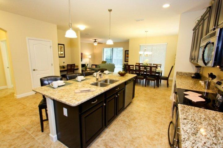 Fully Stocked Eat In Kitchen, Granite Counter Tops, Stainless Steel Appliances - Paradise Villa, near Disney, with Sauna and Hot Tub - Kissimmee - rentals