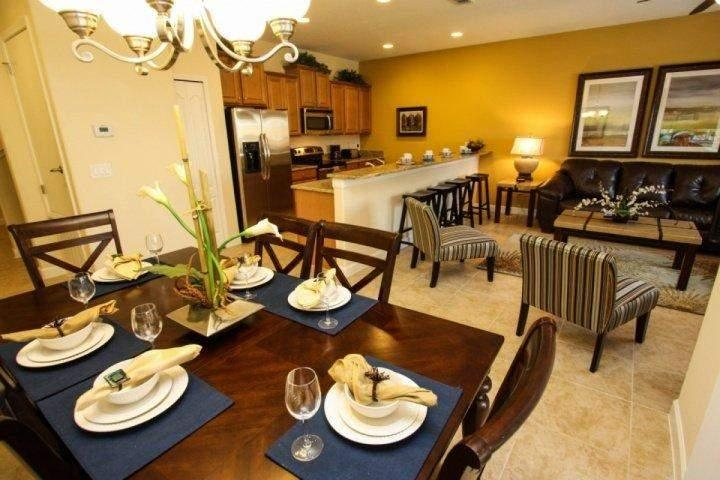 Open Dining Area, Kitchen & Living Area w/Pool Access - Beautiful Paradise Palms Villa with Sauna and Pool - Kissimmee - rentals