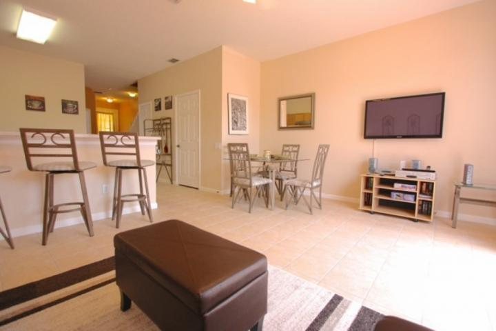 Spacious and comfortable living area with dining accommodations. - 2384 Windsor Palms - Kissimmee - rentals