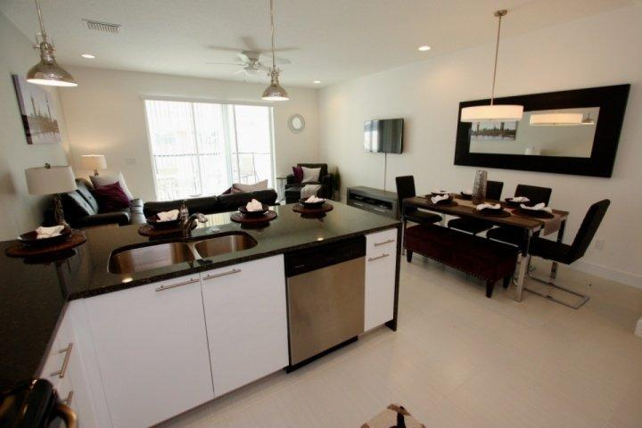 Kitchen area flows into open living and dining space - 17508 Dream - Clermont - rentals