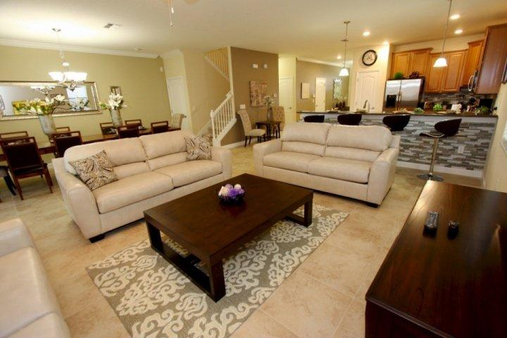 Living space welcomes you with three comfortable couches and large television - 1524 Champions Gate - Davenport - rentals