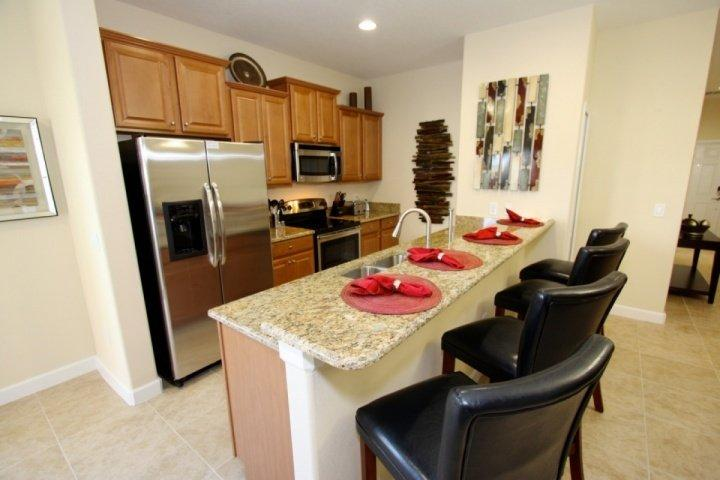 Kitchen includes bar area that seats four - 8951 Paradise Palms - Kissimmee - rentals