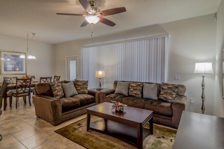 Living Room View w/Pool Access - 2050 Windsor at Westside - Kissimmee - rentals