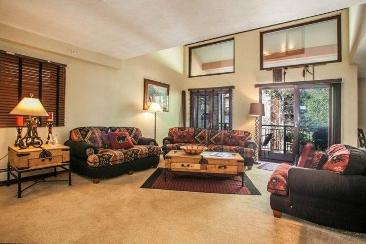 Spacious living room has comfortable seating for 6. Gather with friends and family. Sliding door opens to deck with grill and outdoor seating. - 2 Level Condo, 2 Outdoor Hot Tubs, Heated Pool, On Free Vail Bus Route - Vail - rentals